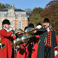 Hunters with hunting horns / bugles during the commemoration of Saint Hubert / Saint Hubertus, Brasschaat, Belgium