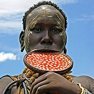 Mursi woman with large clay plate in lower lip, Omo Valley, Ethiopia, Africa