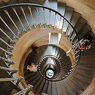 Tourist taking picture of spiral staircase inside the lighthouse Phare des Baleines on the island Ile de Ré, Charente-Maritime, France