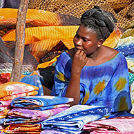 Woman selling colourful cloths on market in Nouakshott, Mauritania, Africa