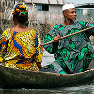 Man and woman in canoe at Ganvie, the lake village, Benin, Africa