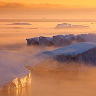 Icebergs, admitted onto UNESCO's World Heritage List, at sunset in the Kangia icefjord, Disko-Bay, West-Greenland, Greenland