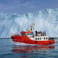 Tourist boat in the Kangia Icefjord, Disko-Bay, West-Greenland, Greenland