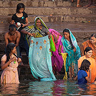 Indian people bathing and praying in the Ganges river at a ghat at Varanasi, Uttar Pradesh, India